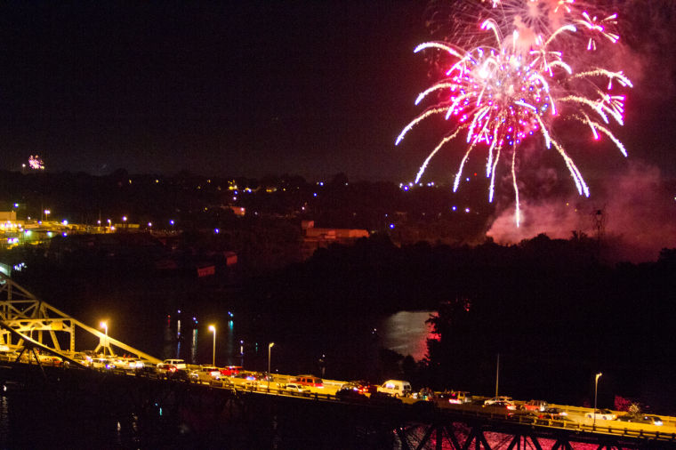 Fireworks being shot over the Tennessee River above O'Neal Bridge.