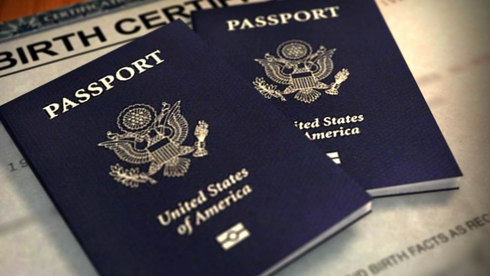 Two passports laying on a table.