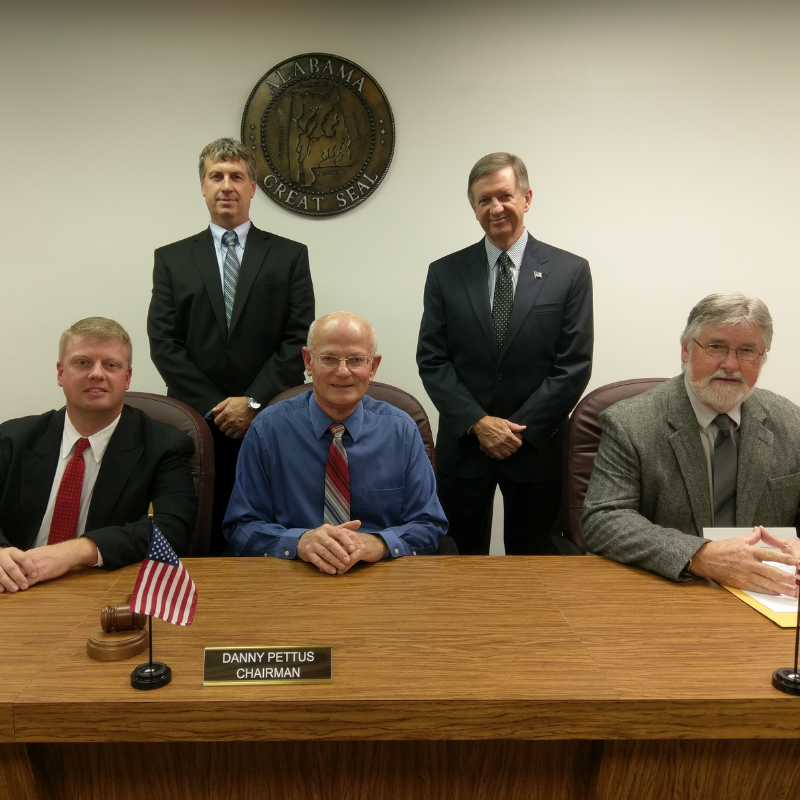 An image of 5 county commissioners.