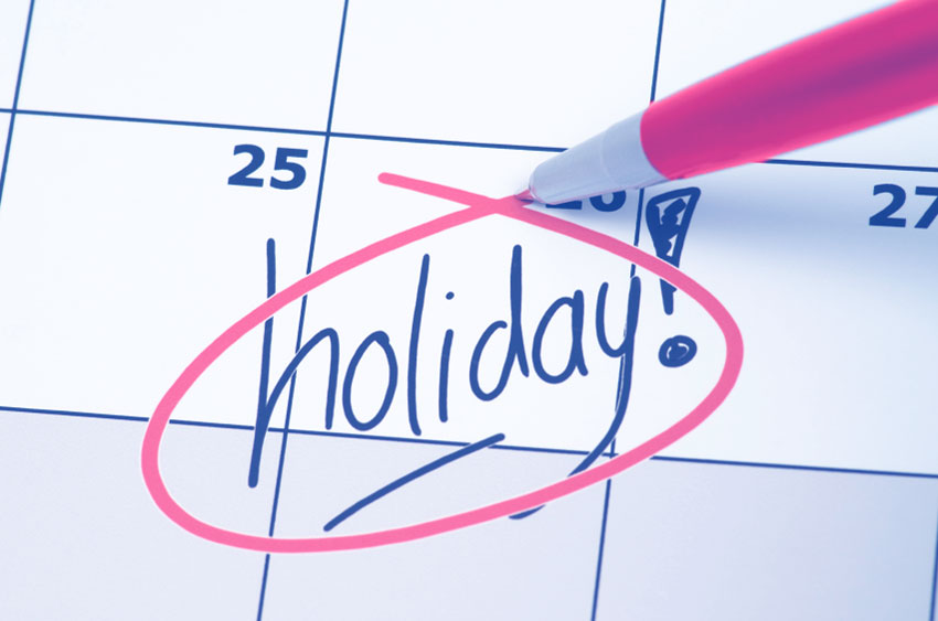 An image of a calendar that has the word holiday! on top of the 26th of the calendar.